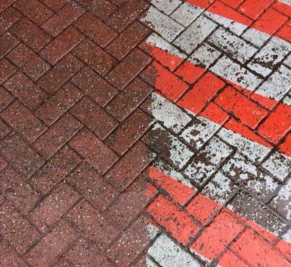 a white paint spill on block paving and a picture of it removed